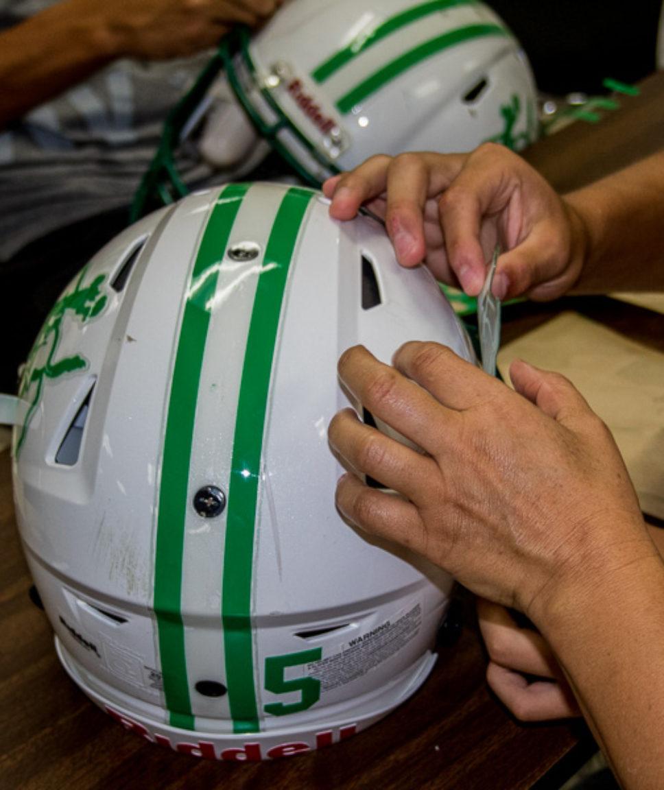 Buckaroos, parents add helmet decals