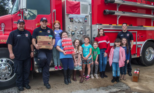 Local Girl Scouts donate smoke detectors to fire department