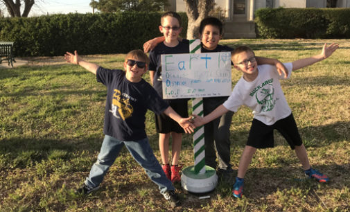 Local Cub Scouts install solar system project