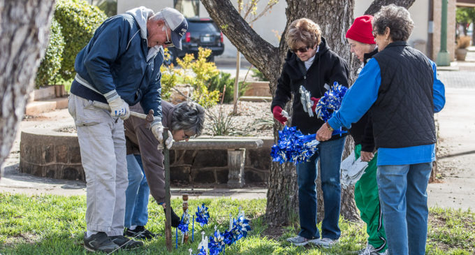 Volunteers decorate courthouse lawn to draw attention to child abuse, neglect