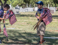 Honoring the fallen: Local Cub Scouts place flags on veterans' graves