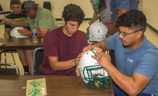 Buckaroos decorate team helmets with dads as they gear up for Jacksboro tonight