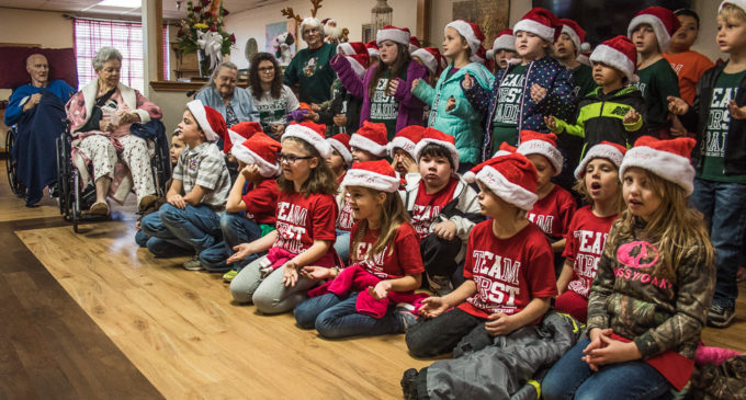 First graders spread Christmas cheer at Villa Haven