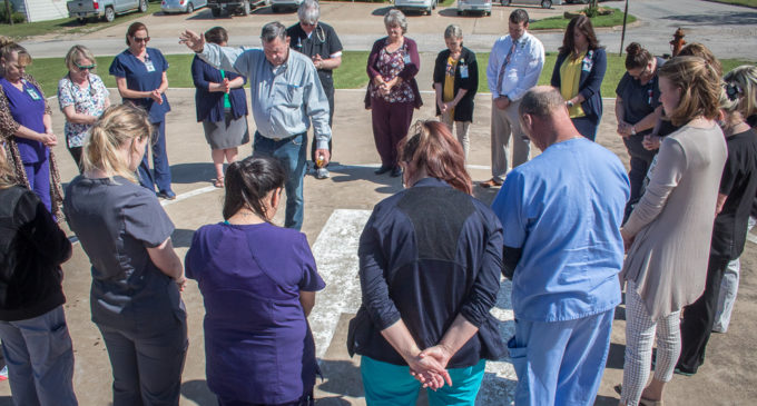 SMH staff gathers for prayer circle on helicopter landing pad