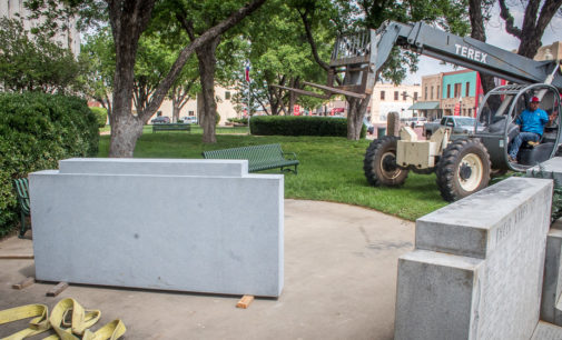 Workers install new monument stone at Stephens County Veterans Memorial