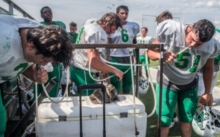 Buckaroos hit the heat with shoulder pads and helmets