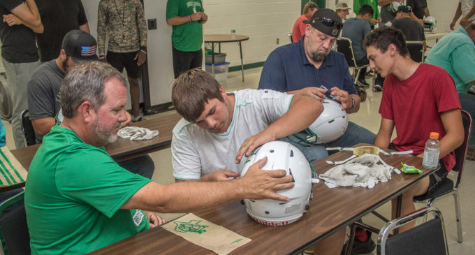 'Decals with Dads' gives parents, Buckaroo football players some extra time together