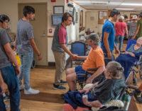 Varsity Buckaroos football players visit Villa Haven residents