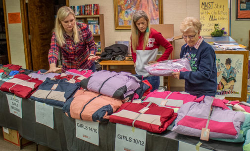 Local Elks Lodge provides coats, books for kids through Warm the Library project