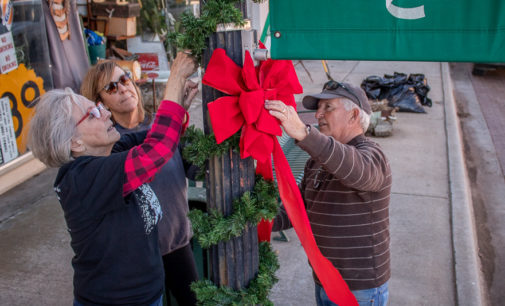 St. Andrew's members clean up and decorate downtown for Christmas