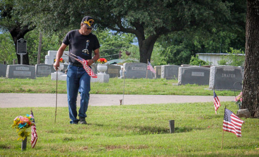 Volunteers help place flags on veterans' graves; Memorial Day ceremony scheduled for 10 a.m. today