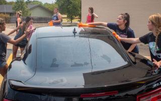 BHS Varsity Cheerleaders brave hot temperatures for car wash fundraiser
