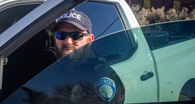 Local business owner provides shade for local police officers
