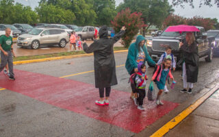 Rain, umbrellas and first day of school in photos