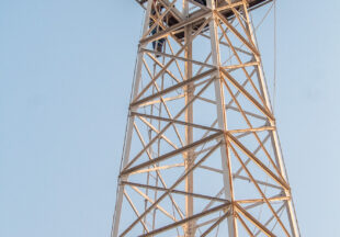 Tommy Wimberley prepares to move vintage oil derrick