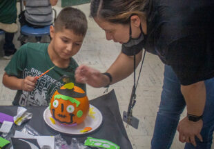 Painting pumpkins at East Elementary